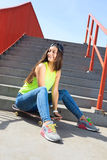 Summer sport. Cool girl skater riding skateboard Stock Images