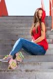 Summer sport. Cool girl skater riding skateboard Royalty Free Stock Photo