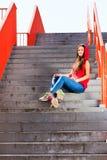 Summer sport. Cool girl skater riding skateboard Royalty Free Stock Image
