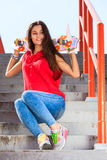 Summer sport. Cool girl skater riding skateboard Royalty Free Stock Photo