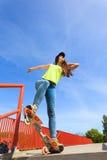 Summer sport. Cool girl skater riding skateboard Royalty Free Stock Photos