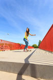Summer sport. Cool girl skater riding skateboard Stock Photos