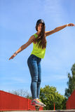Summer sport. Cool girl skater riding skateboard Royalty Free Stock Photography