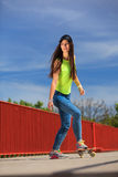 Summer sport. Cool girl skater riding skateboard Royalty Free Stock Images