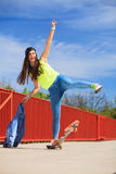 Summer sport. Cool girl skater riding skateboard Stock Image