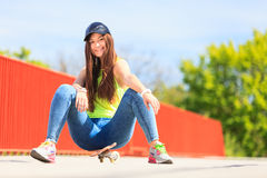 Summer sport. Cool girl skater with skateboard Stock Images