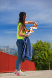 Summer sport. Cool girl skater with skateboard Royalty Free Stock Photography