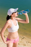 Summer sport fit woman drink water bottle Stock Photography