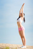 Summer sport fit woman stretching on beach Stock Image
