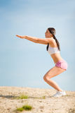 Summer sport fit woman stretching on beach Stock Images