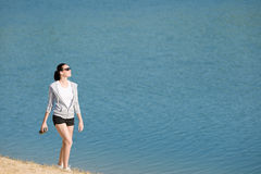 Summer sport fit woman walk on beach Stock Images