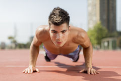 Summer sport. Handsome young man training summer sport Stock Photography