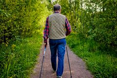 Summer sport for senior people. Nordic walking