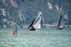 Summer sports on the lake, aychting and padlle board Stock Image