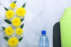 Summer spring flatlay composition yoga mat and bottle of water Stock Images