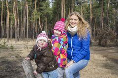 Summer in the spring forest walk Mother with her daughters. Stock Photography