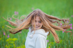 Summer, spring kid with long hair spinning, Royalty Free Stock Photo