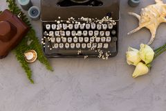 Writing and freelance concept. Vintage typewriter with flowers b. Summer or spring writing and freelance concept. Styped topview photo of vintage typewriter with stock image