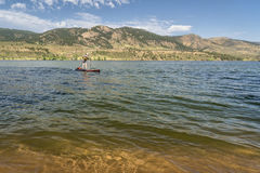 Summer stand up paddleboard on lake in Colorado. Summer recreation on Horsetooth Reservoir in northern Colorado - paddling stand up paddleboard Stock Photo