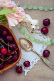 Summer Still Life with berries cherries a silver spoon. And a white porcelain dog Royalty Free Stock Image