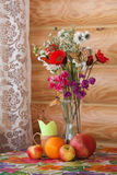 Summer still life with flowers and fruits Stock Photography