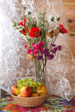 Still life and with flowers and fruits. Summer still life with colorful flowers and fruits Royalty Free Stock Photos