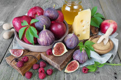 Summer Still Life with figs and cheese Royalty Free Stock Image