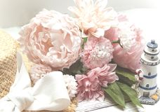 Summer still life, flower bouquet, peonies and daisies royalty free stock image