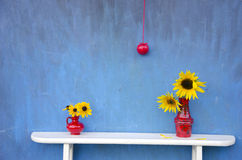 Summer still-life with red vases, flowers and apple Stock Photos