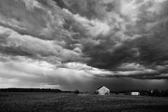 Summer storm. Landscape image of a summer storm over a farm field in B&W Stock Images