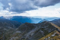 Summer Storm aproaching in the heart of the Fagaras Mountains in Romania. Mountain ridges royalty free stock image
