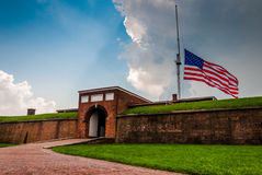 Summer storm clouds and American flag over Fort McHenry in Balti Stock Photos
