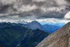 Summer storm clouds arrive in Carnic Alps main ridge. Rocky and grassy slopes of Carnic Alps main ridge from Kinigat with Kellerspitzen, Hohe Warte / Monte Royalty Free Stock Images