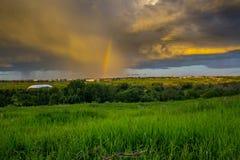 Summer Storm. Thunderstorm with Rainbow. in Calgary, Alberta, Canada Stock Image