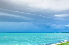 Dramatic before storm view at a turquoise lake stock images