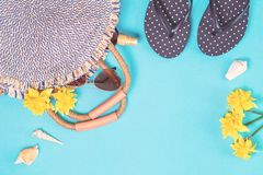 Summer straw bag and flip flops on blue background stock photo