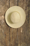 Summer straw hat on an old wooden wall Royalty Free Stock Image