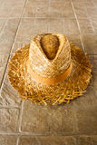 Summer Straw Hat On The Ground Royalty Free Stock Image