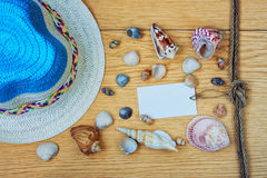 Summer straw hat and seashells Stock Photo