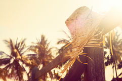 Summer straw hat  on wood fence by the sea. Royalty Free Stock Photography