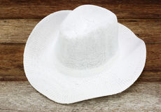Summer straw hat. On wooden background royalty free stock images
