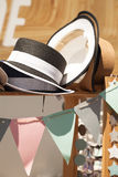 Summer straw hats in a decorated festive shop window. Beautiful vintage hats sale stall at a market Stock Photography