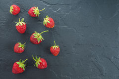 Summer strawberry on black stone delicious berry Royalty Free Stock Photo