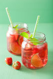 Summer strawberry drink with lime and mint in jars Royalty Free Stock Photos