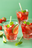Summer strawberry lemonade with lime and mint Stock Photo
