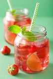 Summer strawberry lemonade with lime and mint in jars Royalty Free Stock Photo