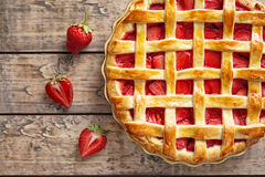 Summer strawberry pie tart cake traditional baked pastry food. On rustic wooden table background Royalty Free Stock Image