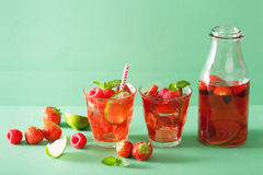 Summer strawberry raspberry drink with lime and mint Royalty Free Stock Image