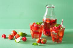 Summer strawberry raspberry lemonade with lime and mint Stock Photography