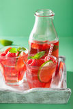 Summer strawberry raspberry lemonade with lime and mint Stock Image
